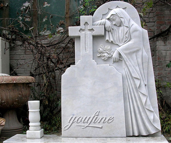 Religious monuments with virgin mary relief decoration