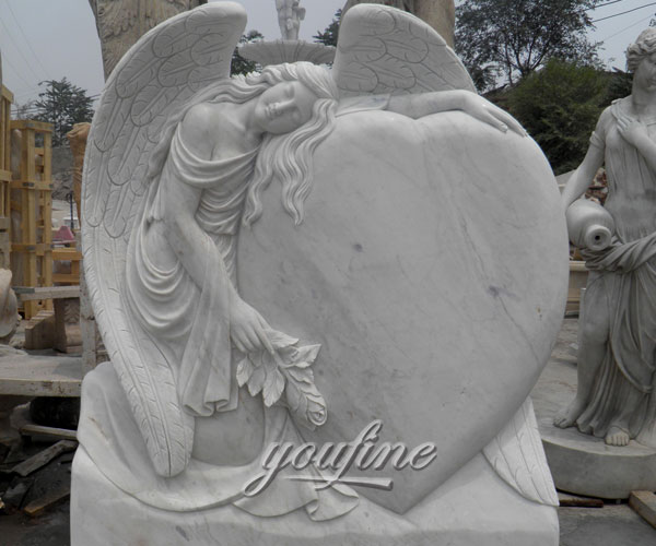 Upright stone carved fallen angel hold heard memorial