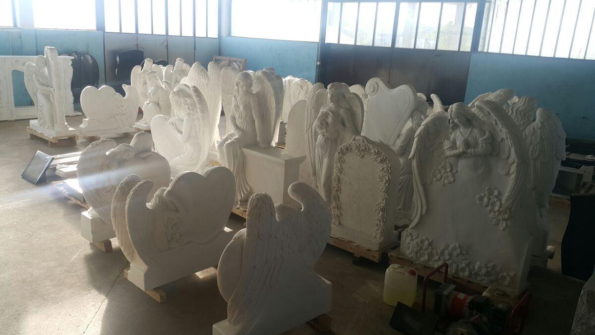 fallen angel headstone, weeping angel tombstone, or praying angel monument